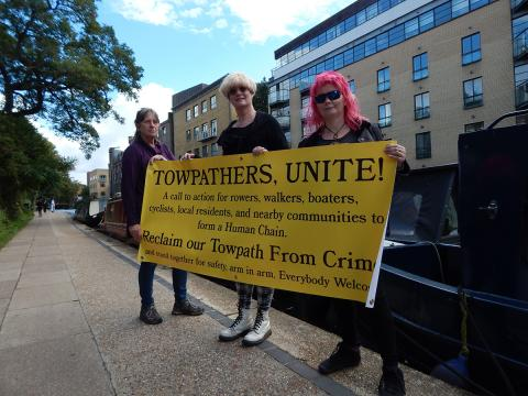 Photo of Reclaim the Towpath banner